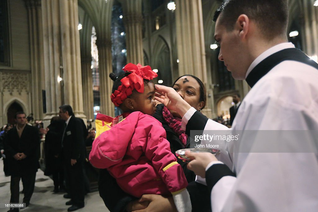 A child receives a cross of black ashes on her forehead on Ash Wednesday at St. Patrick's Cathedral on February 13, 2013 in New York City. Ash Wednesday marks the beginning of Lent, a 40-day period of pray and fasting for many Christians.