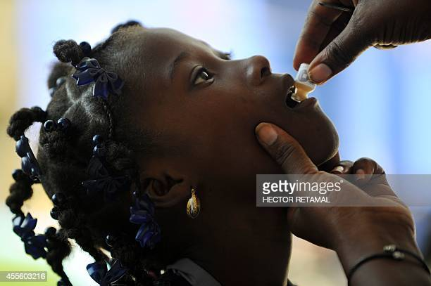 A child receives the second dose of the vaccine against cholera in Saut d'Eau in the Central Plateau of Haiti on 17 September 2014 The UN has...