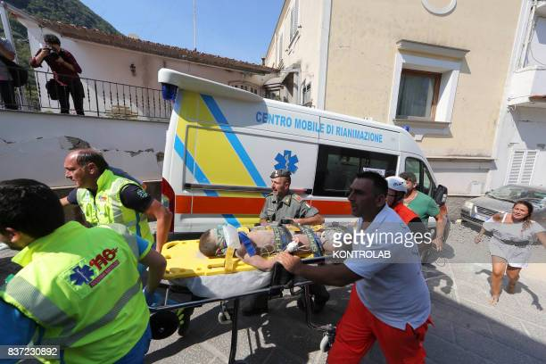 CASAMICCIOLA ISCHIA CAMPANIA ITALY A child recovered from rubble and transported by doctors after the earthquake in Ischia In the night a 4degree...
