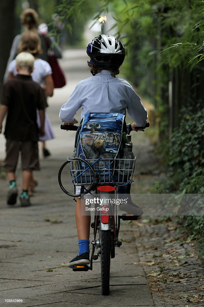 A child rides a bicycle on his way to school on the first school day on August 23, 2010 in Berlin, Germany. Many German school districts, including those in Berlin, are reducing the school times pan from 13 to 12 years as part of a nationwide set of primary and secondary school reforms.