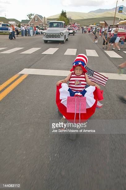 Child riding a bike in the Independence Day Parade in Lima Montana