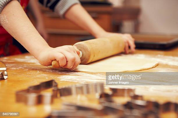 Child rolling dough