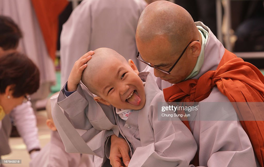 A child rubs his head after a Buddhist monk shaved his hair off during the 'Children Becoming Buddhist Monks' ceremony forthcoming buddha's birthday at a Chogye temple on May 3, 2013 in Seoul, South Korea. The children will stay at the temple to learn about Buddhism for 14 days. Buddha was born approximately 2,557 years ago, and although the exact date is unknown, Buddha's official birthday is celebrated on the full moon in May in South Korea, which is on May 17 this year.