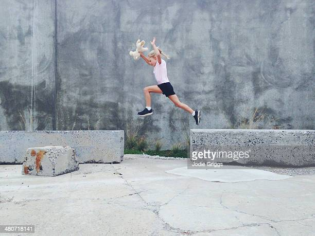 Child running & leaping from one object to another