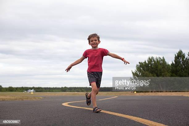 child running on asphalt