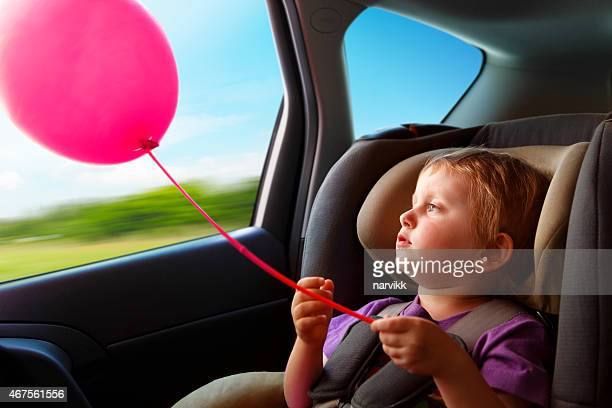 Child safely traveling in the baby car seat