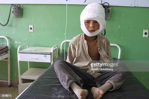 A child said to have been wounded in a US bombing raid sits November 2 2001 in a hospital in Kandahar Afghanistan