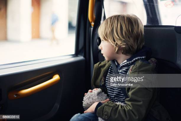Child sat in a car looking out of the window