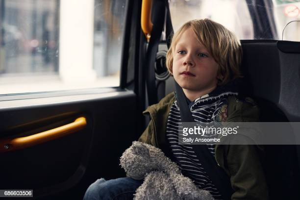 Child sat in a car