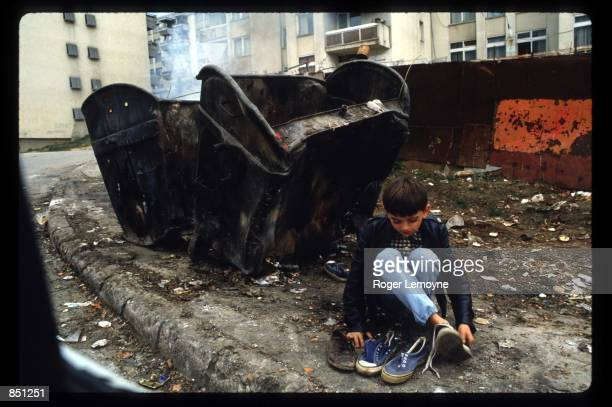 A child scavenges shoes December 1 1994 in Sarajevo BosniaHerzegovina When Bosnia declared its independence in March of 1992 the Bosnian Serbs set up...