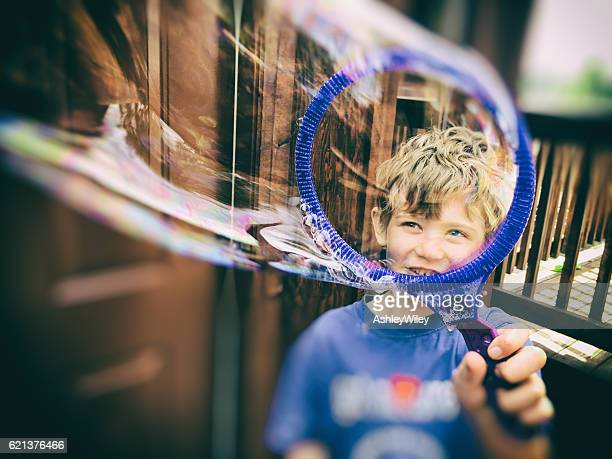 Child seeing through a bubble