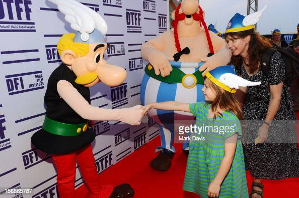 A child shakes the hand of Asterix at the 'Asterix and Obelix 3D' Premiere during the 2012 Doha Tribeca Film Festival at o n November 23 2012 in Doha...