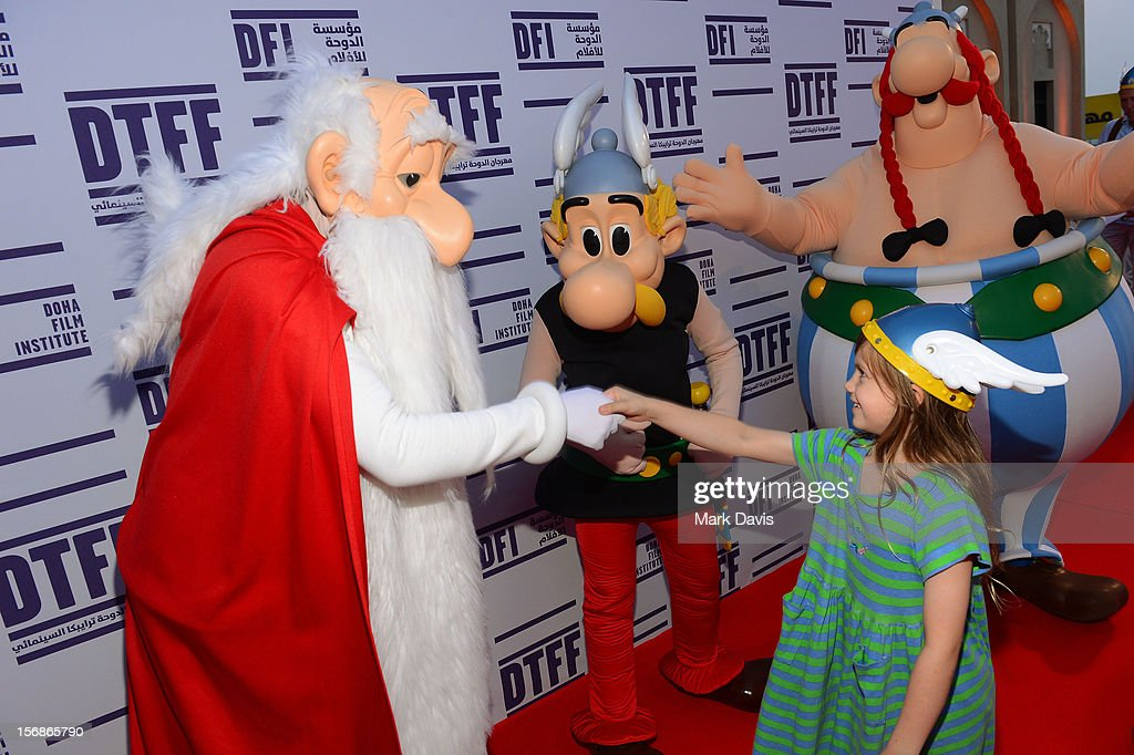 A child shakes the hand of Getafix at the 'Asterix and Obelix 3D' Premiere during the 2012 Doha Tribeca Film Festival at o n November 23, 2012 in Doha, Qatar.