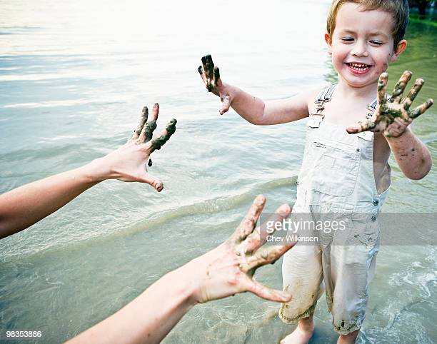 child showing dirty hands