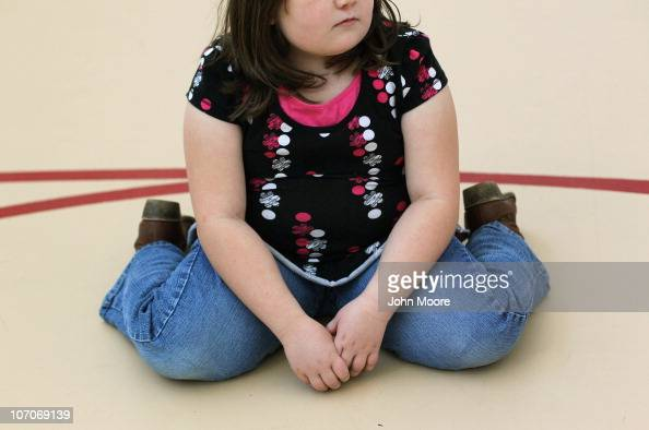 A child sits on the gym floor during the Shapedown program for overweight adolescents and children on November 13 2010 in Aurora Colorado The 10week...