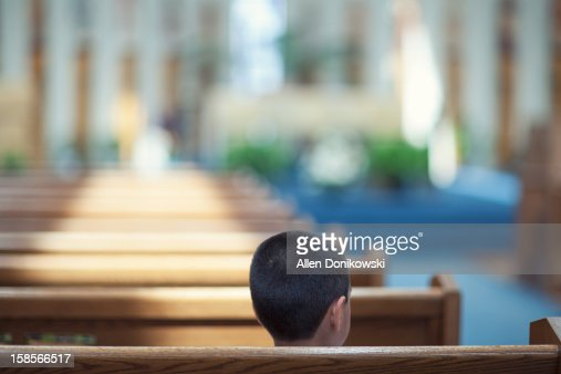 child sitting alone in church