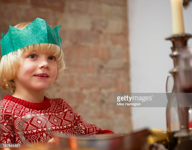 Child sitting at dinner table at Christmas.