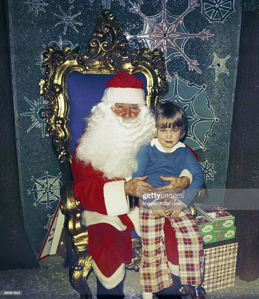 Child sitting on lap of Santa Clause