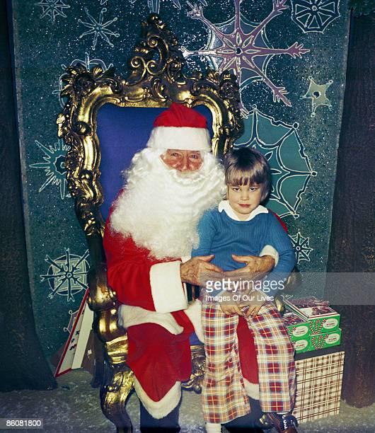 Child sitting on lap of Santa Clause