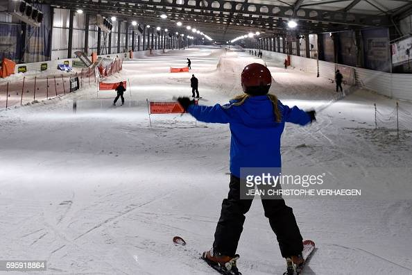 A child skies at the Snowhall the only indoor ski run in France in Amneville eastern France on August 26 2016 as a heatwave strikes all France In...
