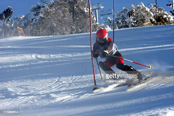 Child Skiing ski race in the mountain snow