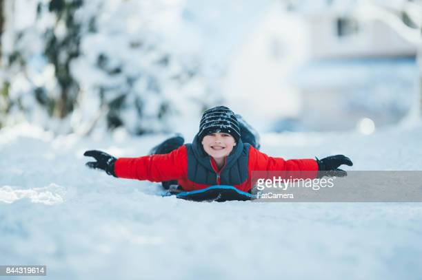 Child sledding in snow