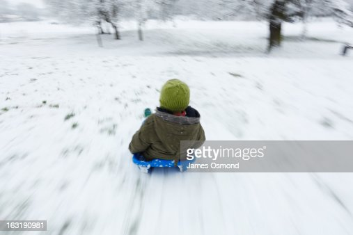 Child Sledging. : Stock Photo