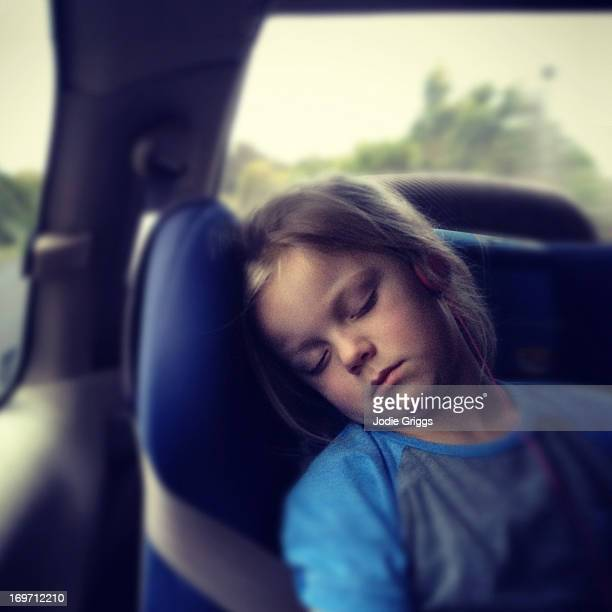 Child sleeping in the back of a car
