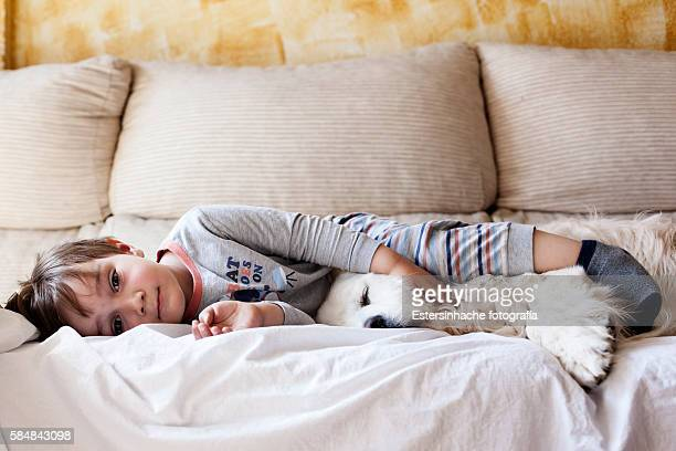 Child sleeping with his dog