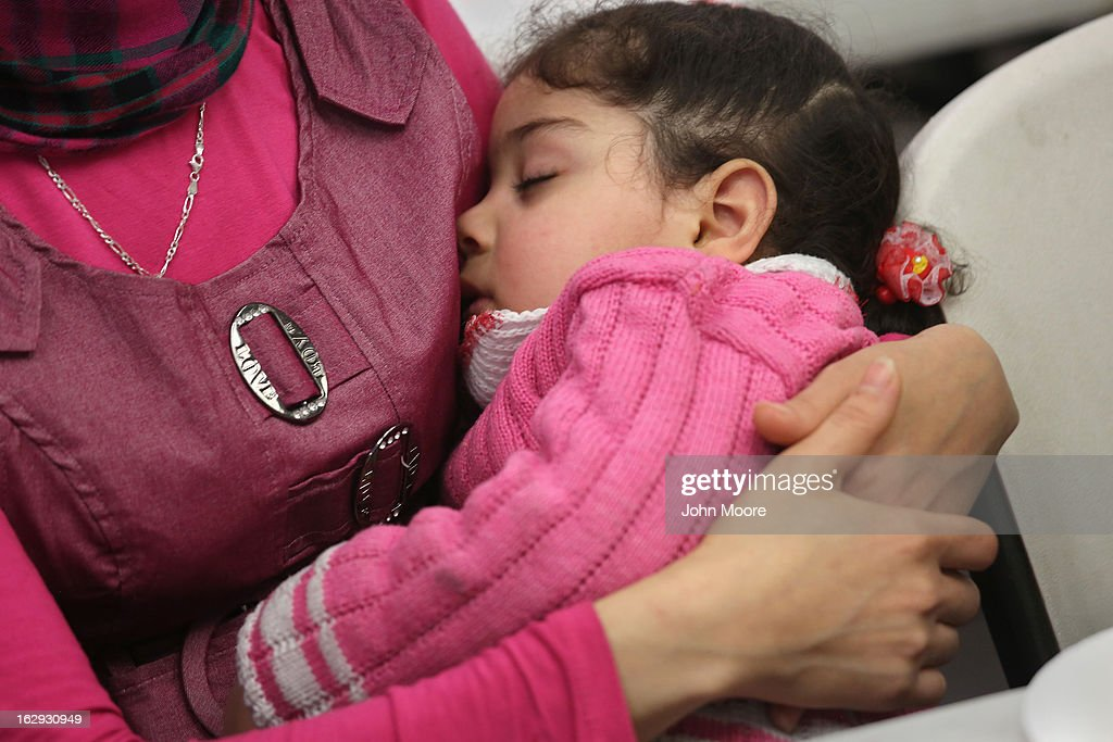 A child sleeps as her mother, a recently-arrived refugee from Iraq, learns how to receive food stamps during a class held by the Arizona Department of Economic Security at the International Rescue Committee (IRC), office on March 1, 2013 in Phoenix, Arizona. IRC programs like many programs that receive federal funding, may be greatly cut back due to federal sequestration cuts. The IRC is a non-profit humanitarian aid organization that aids refugees and survivors of international conflict. They assist new arrivals, many of whom come from refugee camps and war zones, to adjust to American society after being granted refugee status and invited by the U.S. government to live in the United States. The IRC also assists refugees through the immigration and naturalization process to become U.S. citizens.