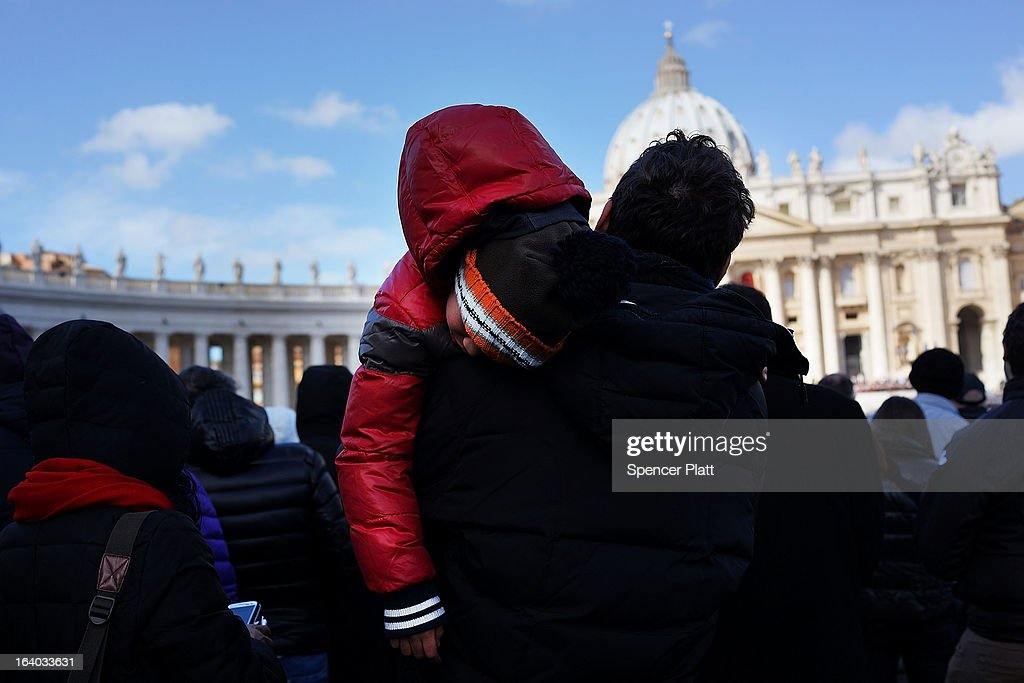 A child sleeps during the Inauguration Mass for Pope Francis in St Peter's Square on March 19, 2013 in Vatican City, Vatican. The mass is being held in front of an expected crowd of up to one million pilgrims and faithful who have filled the square and the surrounding streets to see the former Cardinal of Buenos Aires officially take up his role as pontiff.