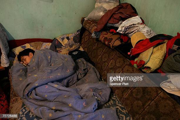A child sleeps in a room he shares with four other family members in a derelict building December 5 2006 in Bucharest Romania Romania a country of...