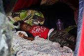 A child sleeps in a tent in an encampment of Africans in Penas Blancas Guanacaste Costa Rica in the border with Nicaragua on July 19 2016 In a...