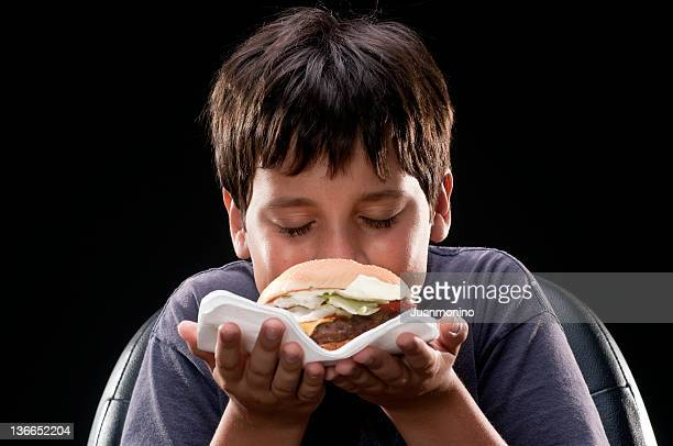 Child smelling a hamburger