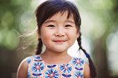 Child smiling cheerfully at camera