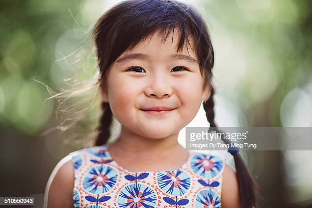 Child smiling cheerfully at camera