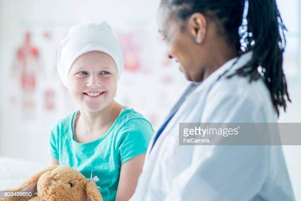 Child Smiling with Doctor