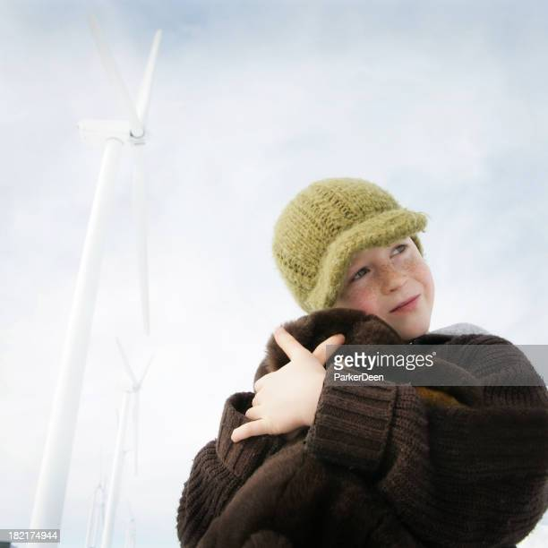 Child Snuggling with Teddy Bear Renewable Energy-  Wind Turbines
