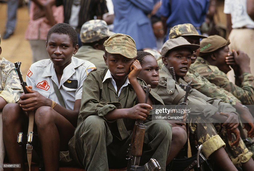 Child soldiers watch the inauguration of Yoweri Museveni National Resistance Army leader who overthrew Ugandan President Milton Obote and became...