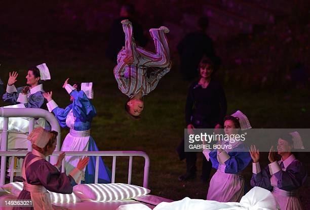 A child somersaults as he jumps on a hospital bed during the Great Ormond Street Hospital scene in the opening ceremony of the London 2012 Olympic...