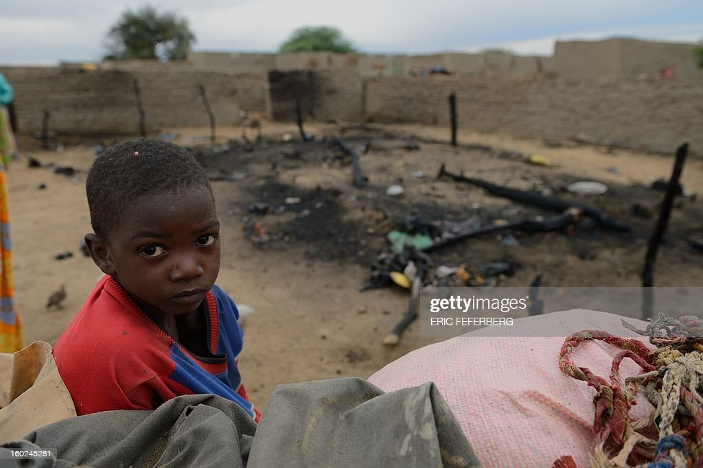 A child stand next to his house destroyed by a French airstrike on January 27, 2013 in Lere. French-led forces on Janaury 28, 2012 seized Mali's fabled desert city of Timbuktu in a lightning advance north as fleeing Islamists torched a building housing priceless ancient manuscripts.