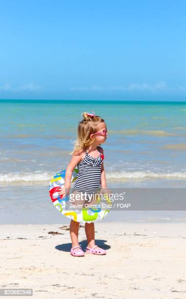 Child standing on beach
