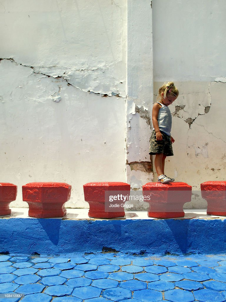 Child Standing on Red Block : Stock Photo
