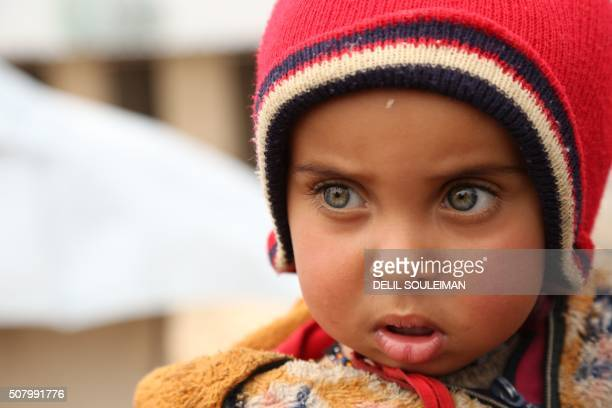 TOPSHOT A child stands at a new refugee camp set up for Iraqis mostly fleeing the northern city of Mosul now held by the Islamic State group on the...