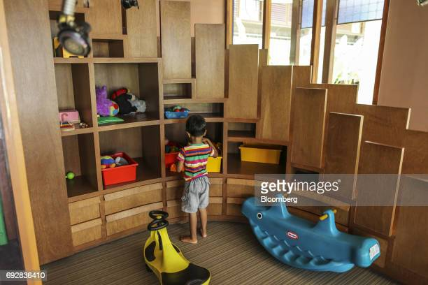 A child stands inside a play room of a health club in Palava City on the outskirts of Mumbai India on Thursday May 25 2017 Lodha Group best known for...