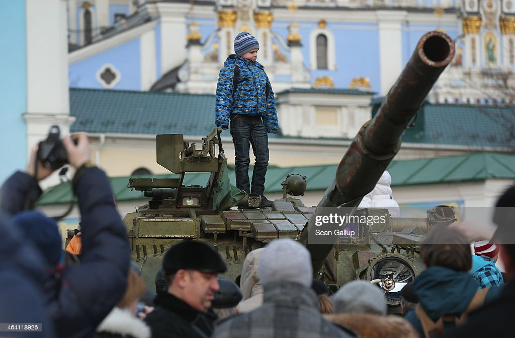 A child stands on top of a heavy tank that is part of an exhibition of weapons drones documents and other materials the Ukrainian government claims...