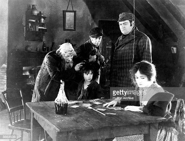 Child star Jackie Coogan plays Oliver alongside Lon Chaney as Fagin and Gladys Brockwell as Nancy in the silent movie version of 'Oliver Twist'