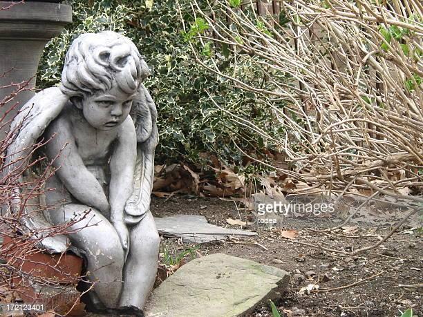 child stone statue