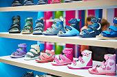 Childrens summer shoes on store shelves