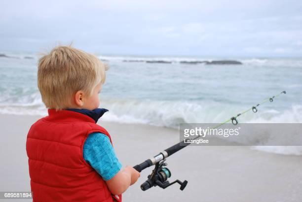 Child Surf Fishing in Summer
